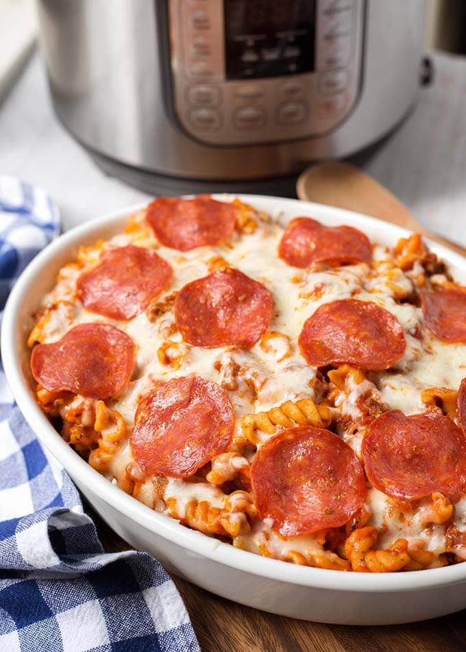 Instant Pot Pizza Pasta Casserole is a delicious, hearty one-pot meal. You can make this pressure cooker pizza pasta casserole with your favorite pizza toppings, and in under an hour! Pizza in a pot! simplyhappyfoodie.com #instantpotrecipes #instantpotpizzapastz #pressurecookerpizzapasta