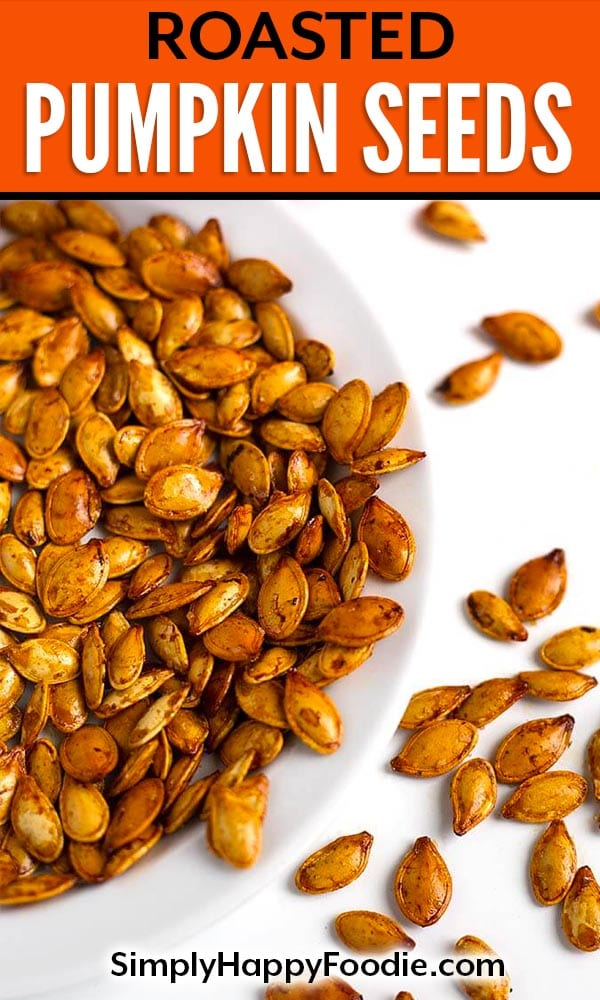 Roasted Pumpkin Seeds are a tasty and healthy snack. We enjoy them with different flavors, and this method works with all squash seeds. Roasted squash seeds are a fun treat! How to make roasted pumpkin seeds by simplyhappyfoodie.com #roastedpumpkinseeds #pumpkinseeds