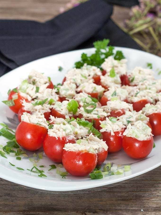 several tomato bites on a white platter