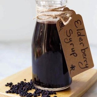 Instant Pot Elderberry Syrup is a wonderful, earthy and sweet syrup. It is believed to be a great antioxidant, and a natural remedy for warding off colds and the flu! Pressure cooker Elderberry Syrup has ingredients to enhance the flavor, and they also have potential health benefits. It tastes great! simplyhappyfoodie.com #instantpotelderberrysyrup #pressurecookerelderberrysyrup