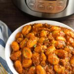 Instant Pot Sausage Gnocchi is a rich and hearty dish that has lots of flavor, and is so good, especially on a cool Fall or Winter evening. This pressure cooker sausage and gnocchi is cooked in a tomato sauce with Italian spices, and is ready in under an hour! One of my top 5 Instant Pot recipes. simplyhappyfoodie.com #instantpotsausagegnocchi #instantpotrecipes #pressurecookerrecipes #italiangnocchirecipe