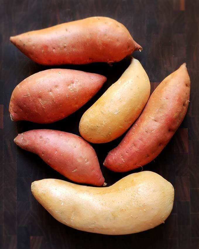 Instant Pot Sweet Potatoes are delicious and healthy. Best of all, these pressure cooker sweet potatoes are so easy to make! Pile on your favorite toppings and you have a delicious vegetable side dish, or a main course tasty Instant Pot Sweet Potato or Instant Pot Yams! simplyhappyfoodie.com #instantpotsweetpotatoes #pressurecookersweetpotatoes #instantpotyams #pressurecookeryams