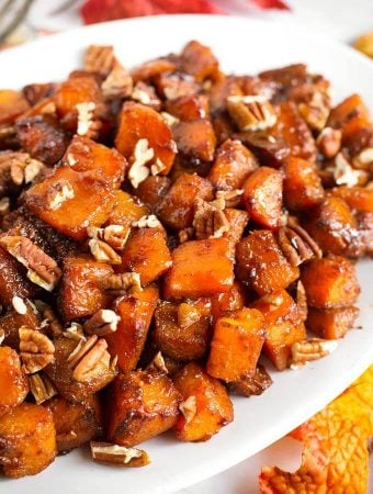 Closeup of Cinnamon Roasted Butternut Squash on a white oblong platter