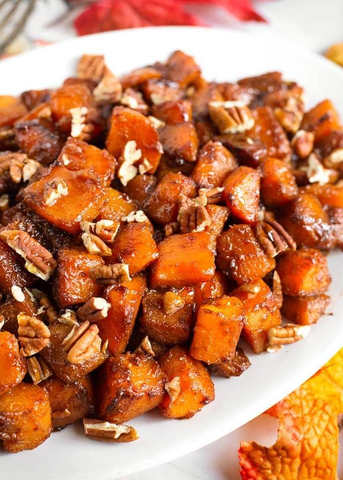 Cinnamon Roasted Butternut Squash on a white oblong platter