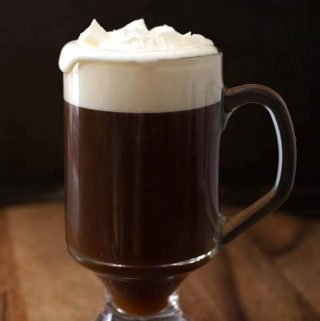 Enjoy this delicious Classic Irish Coffee Recipe on a cool evening, or a special gathering. We like to drink Irish Coffees during the Holidays, and when we are inside on a snowy day. This is the original Irish Coffee recipe from the Buena Vista Cafe. simplyhappyfoodie.com #irishcoffee #originalirishcoffeerecipe