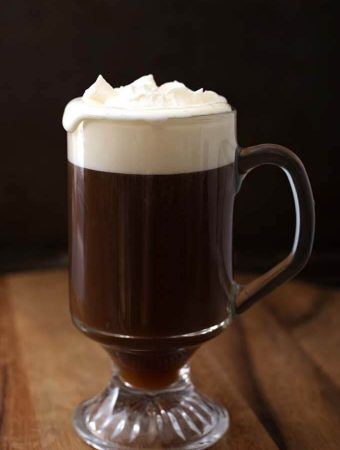 Classic Irish Coffee Recipe in a glass on a wooden board