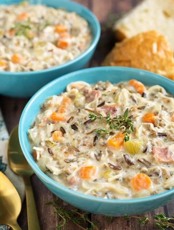 Crock Pot Creamy Chicken Wild Rice Soup is delicious, thick, rich, and so simple to make! Slow cooker creamy chicken wild rice soup is a hearty one pot meal that is perfect for Fall. My whole family loves this soup! simplyhappyfoodie.com #wildricesoup #crockpotchickenwildricesoup #slowcookerwildricesoup