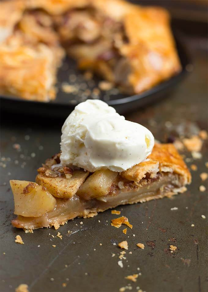 This Easy Apple Galette recipe is really an apple pie without the pie pan! It is a rustic apple pie dessert that is really easy and fast to make. A premade pie crust is a great shortcut to make this wonderful apple galette. Apple crostata simplyhappyfoodie.com #applegalette #galette