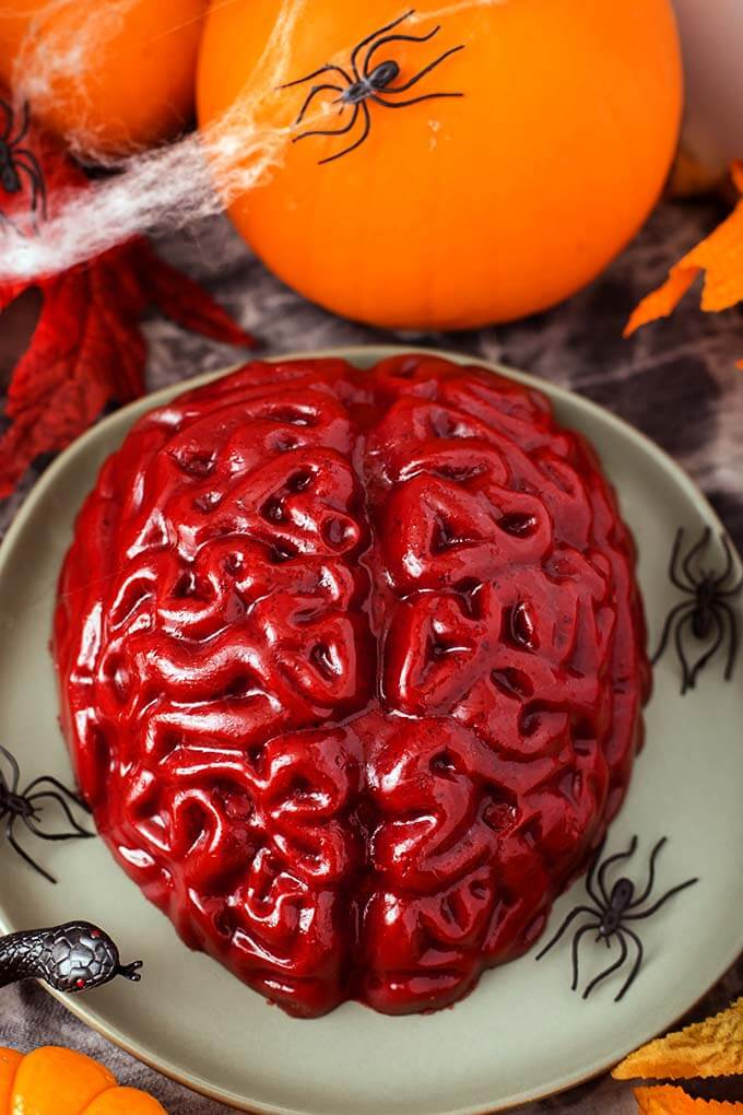 This Halloween Jello Brain Recipe for a brain mold makes a creepy gelatin brain that you can take to a Halloween party, or anywhere a jello brain would be appropriate. The Zombie Apocalypse comes to mind... Halloween recipe by simplyhappyfoodie.com #halloween #gelatinbrain