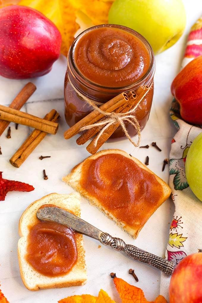Instant Pot Apple Butter is absolutely divine! This recipe is everything good about Fall, in one sweetly spiced condiment! Pressure Cooker Apple Butter is easy to make in your Instant Pot, and the results are a smooth, velvety, Autumn spread that is delicious on toast, muffins, pancakes, and by the spoonful! Instant Pot Recipes by simplyhappyfoodie.com #instantpotapplebutter #pressurecookerapplebutter