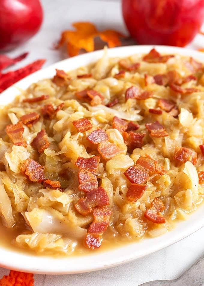Instant Pot Braised Cabbage and Apples have a wonderful tart-sweet flavor, with a savory edge. This is a delicious recipe to make in your Instant Pot! Pressure cooker braised cabbage and apples is a Fall comfort food. A perfect Instant Pot Thanksgiving side dish! simplyhappyfoodie.com #instantpotbraisedcabbage #pressurecookerbraisedcabbage
