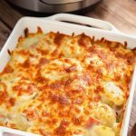 Instant Pot Scalloped Potatoes have a delicious flavor, especially when you use a smoky ham and some nice cheese for extra creaminess. These pressure cooker scalloped potatoes cook much faster than in the oven, and are my family's favorite Easter side dish, as well as Thanksgiving side dish! Instant Pot recipes by simplyhappyfoodie.com #instantpotscallopedpotatoes #pressurecookerscallopedpotatoes