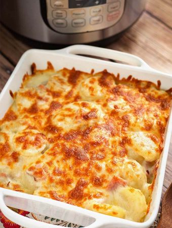 Scalloped Potatoes in a white square baking dish