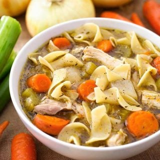 Instant Pot Chicken Noodle Soup, made with a whole chicken, tastes like you cooked it for hours! The pressure cooker extracts the flavor from the chicken for a rich, flavorful broth. But it takes less than two hours! This pressure cooker Chicken Noodle Soup recipe is a classic! Instant Pot recipes by SimplyHappyFoodie.com #instantpotchickennoodlesoup #pressurecookerchickennoodlesoup