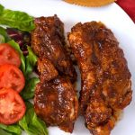 Instant Pot Country Style Ribs are delicious and easy to make. You will get fork tender meat that is flavored with a spice rub, and finished with tangy barbecue sauce. Pressure cooker country style pork ribs are a great weeknight meal that is ready in under an hour! Instant Pot recipes by simplyhappyfoodie.com #instantpotcountrystyleribs #instantpotribs #pressurecookercountrystyleribs #pressurecookerribs