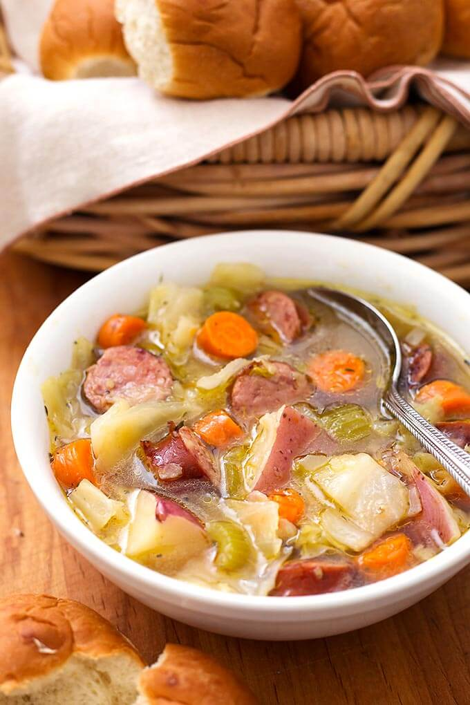 Instant Pot Kielbasa Cabbage Potato Soup is a Fall soup if ever there was one! This simple and rustic soup has a rich broth and chunky carrots, green cabbage, and tasty smoked kielbasa. This pressure cooker Kielbasa Cabbage Potato Soup recipe is one of my family's favorites! simplyhappyfoodie.com #instantpotrecipes #instantpotsoup #instantpotcabbagepotatosoup #pressurecookersoup