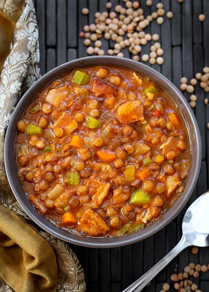 Instant Pot Lentil Soup is a rich, healthy, and delicious medley of brown lentils, carrots, celery, spices, and bacon. This pressure cooker lentil soup is hearty without being heavy. A very popular Instant Pot soup recipe. Instant Pot recipes by simplyhappyfoodie.com #instantpotlentilsoup #pressurecookerlentilsoup