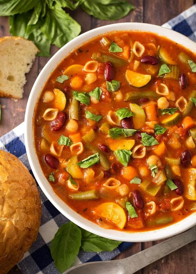 Instant Pot Minestrone Soup is a classic Italian soup loaded with vegetables, beans, pasta, and lots of flavor! When you make this pressure cooker minestrone soup, clean out that vegetable drawer in the fridge! This is a versatile and tasty Instant Pot soup recipe! Instant Pot Recipes by simplyhappyfoodie.com #instantpotminestronesoup #instantpotsoup #pressurecookerminestrone #pressurecookersouprecipe