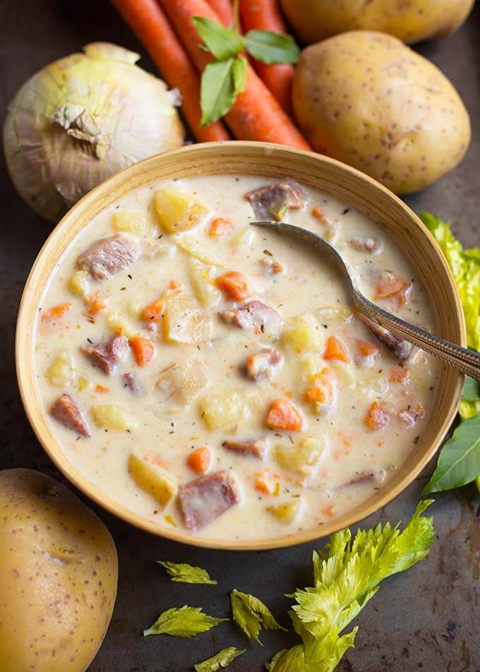 Instant Pot Potato Ham Soup is so delicious! Use some leftover ham, or get some from the deli, throw in some potatoes, and a few veggies, some seasonings, and you will have a rich and creamy, but not heavy, pressure cooker Potato Ham Soup! Simplyhappyfoodie.com #instantpotpotatohamsoup #pressurecookersoup