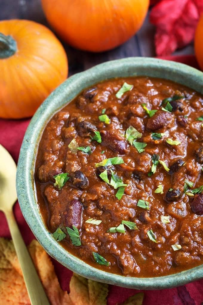 Instant Pot Pumpkin Chili is a delicious Fall comfort food. A hearty chili that isn't too heavy, with the addition of creamy, healthy pumpkin puree. Pressure cooker pumpkin chili is so flavorful and satisfying! simplyhappyfoodie.com #instantpotrecipes #instantpotpumpkinchili #instantpotchili #pressurecookerchili
