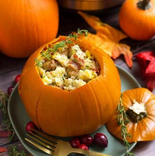 Instant Pot Stuffed Pumpkin is so delicious! This is a Fall recipe that can be a main dish or a side dish. A pumpkin stuffed with a savory and creamy stuffing that you can change up to make it your own! This pressure cooker stuffed pumpkin is as beautiful as it is scrumptious! Instant Pot recipes by simplyhappyfoodie.com #instantpotstuffedpumpkin #instantpotpumpkin #instantpotthanksgiving #pressurecookerpumpkin