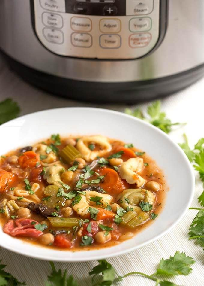 Instant Pot Vegetable Tortellini Soup is delicious, vegetarian, and full of healthy veggies in a rich and flavorful broth. The cheese tortellini has a nice texture. This pressure cooker vegetable tortellini soup is a vegetarian delight! Instant pot soup recipes and Instant Pot recipes by simplyhappyfoodie.com #instantpotvegetablesoup #instantpotvegetabletortellinisoup