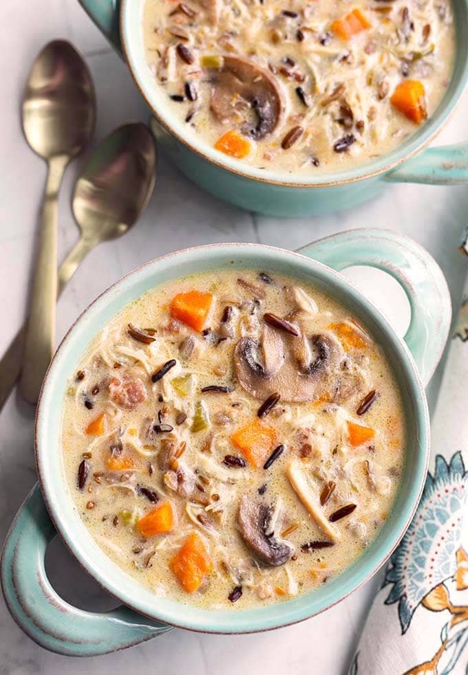 Instant Pot Wild Rice Soup with Chicken is delicious and hearty. With wild rice, mushrooms, herbs and a creamy broth. Pressure Cooker wild rice soup is amazing and easy to make! simplyhappyfoodie.com #instantpotwildricesoup #pressurecookerwildricesoup