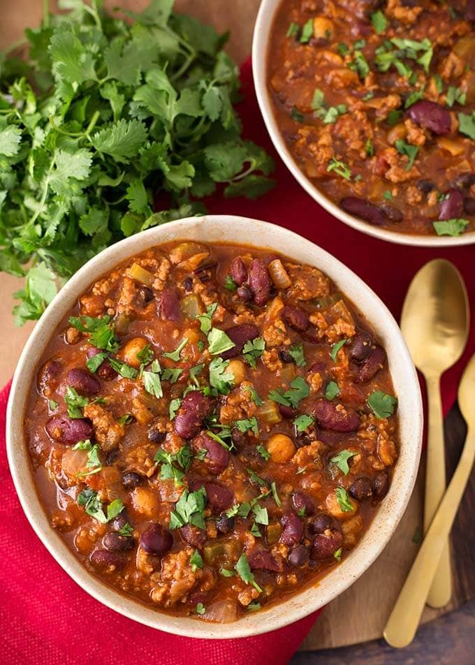 My Slow Cooker Turkey Chili Recipe has been a yummy staple in our home for over 10 years. Ground turkey, beans, a few veggies, and spices all loaded into the slow cooker to make the best healthy turkey chili recipe! Crock pot turkey chili is a delicious one-pot meal, and feeds a crowd! slow cooker chili by simplyhappyfoodie.com #slowcookerturkeychili #crockpotturkeychili