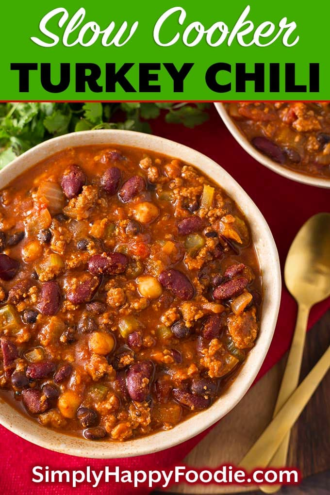 This delicious Slow Cooker Turkey Chili Recipe has ground turkey, beans, veggies, & spices all loaded into the slow cooker to make the best crock pot turkey chili recipe. Crock pot turkey chili is a delicious one-pot meal, and feeds a crowd! Slow cooker chili recipe by simplyhappyfoodie.com #slowcookerturkeychili #crockpotturkeychili