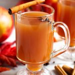 My Spiced Apple Hot Toddy recipe will warm you up from the inside. A deliciously sweet and spiced apple cider cocktail that is perfect for a chilly Fall or Winter evening. A hot cocktail recipe by simplyhappyfoodie.com #spicedapplehottoddy #hottoddy