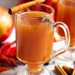 Spiced Apple Hot Toddy in a glass with a handle topped with a cinnamon stick and anise seed