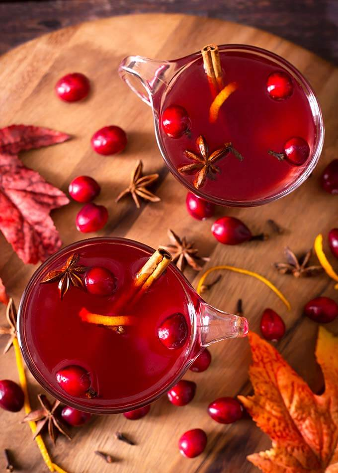 A Spiced Cranberry Hot Toddy is sweet and tart, gently spiced, and very delicious! This hot cocktail is a branching off of the traditional Hot Toddy recipe, and we really like this flavorful version of the Hot Toddy with cranberry juice. simplyhappyfoodie.com #cranberryhottoddy #hottoddy