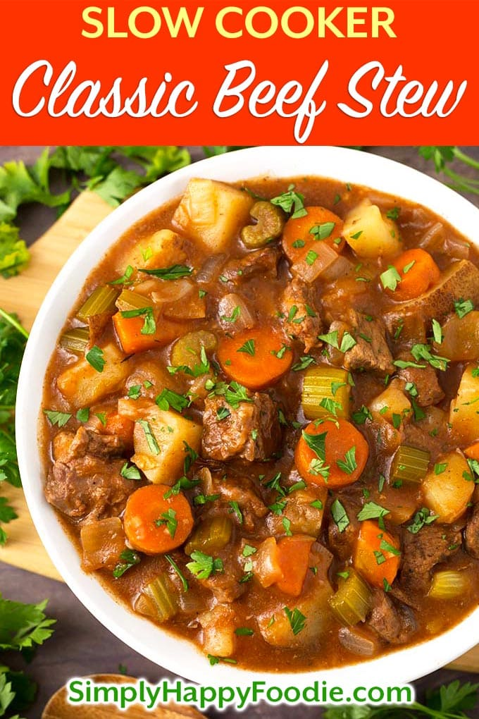 Classic Slow Cooker Beef Stew tastes just like the stew my mom used to make. No need for packaged soups in this comforting slow cooker beef stew. This crock pot beef stew recipe makes a lot, so you can feed a crowd! The best crock pot beef stew by simplyhappyfoodie.com #slowcookerbeefstew #crockpotbeefstew