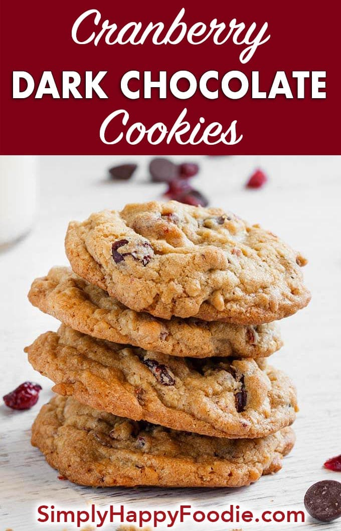 Cranberry Dark Chocolate Cookies are a sweet and slightly tart cookie. The dried cranberries accent the delicious dark chocolate and oatmeal in this tasty cookie recipe. These cookies are perfect for a Holiday cookie exchange! simplyhappyfoodie.com #cranberrydarkchocolatecookies #holidaycookies