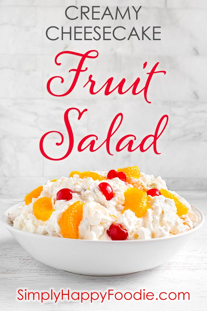 Creamy Cheesecake Fruit Salad is deliciously creamy, and not too sweet. This is a very easy fruit salad to make, with fruit cocktail and other tasty ingredients! This is our favorite Holiday and special occasion fruit salad recipe. simplyhappyfoodie.com #fruitsaladrecipe #cheesecakefruitsalad