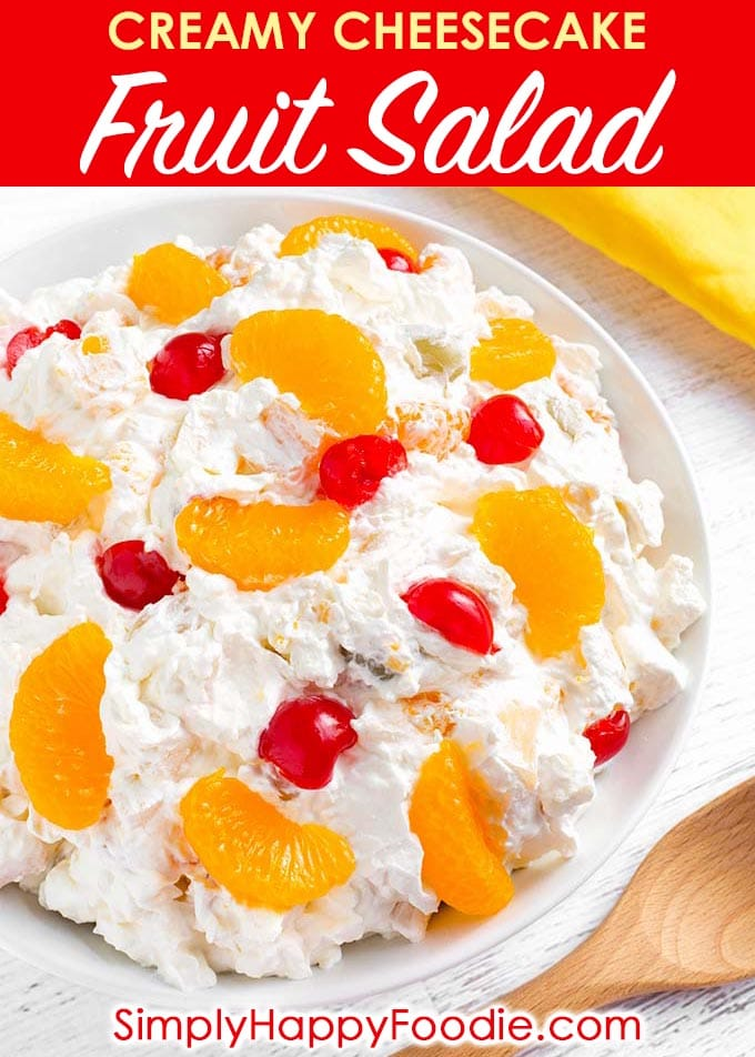 Creamy Cheesecake Fruit Salad is extra creamy, and not too sweet. This is a very easy fruit salad to make, with only 4 ingredients! This is our favorite Holiday and special occasion fruit salad recipe. simplyhappyfoodie.com #fruitsalad #creamyfruitsalad