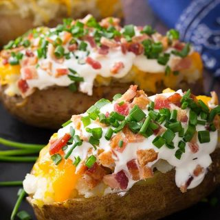 Make a yummy, fluffy Instant Pot Baked Potato, or 4, or even 8 in your electric pressure cooker! Making pressure cooker baked potatoes is so easy, and the resulting baked potato is much better than a microwaved potato! Give these pressure cooked baked potatoes a try! simplyhappyfoodie.com #instantpotbakedpotato #pressurecookerbakedpotato