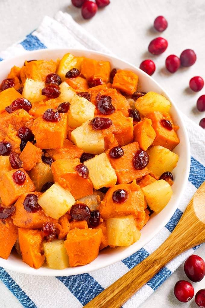 Instant Pot Sweet Potato Cranberry Casserole also has pineapple and warm spices to make this a yummy Fall side dish. It's so fast to make, you will have a wonderful side on the table in 30 minutes or less! Pressure cooker sweet potatoes with cranberries is a tasty addition to to your Holiday meal. A great Instant Pot Thanksgiving side dish recipe! simplyhappyfoodie.com #instantpotswetpotatoes #instantpotthanksgiving