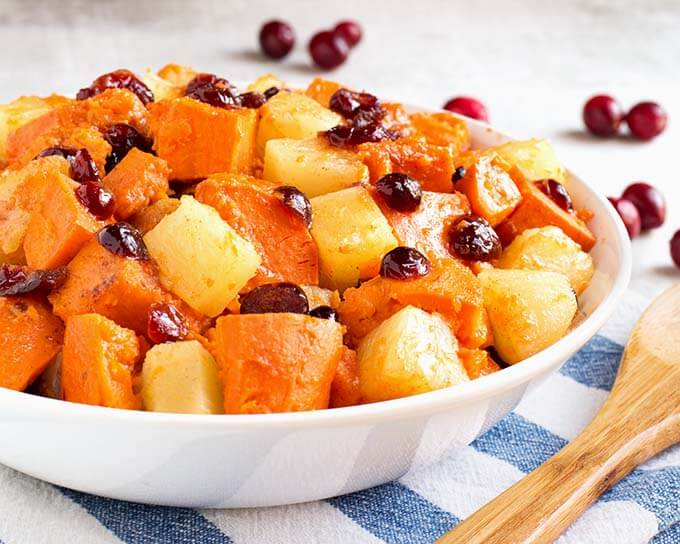 Instant Pot Sweet Potato Cranberry Casserole also has pineapple and some warm spices to make this a yummy Fall side dish. It's so fast to make, you will have a wonderful side on the table in 30 minutes or less! Pressure cooker sweet potatoes with cranberries is a tasty addition to your Holiday meal. A great Instant Pot Thanksgiving side dish recipe! simplyhappyfoodie.com #instantpotswetpotatoes #instantpotthanksgiving