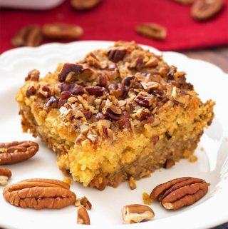 Pumpkin Pie Dump Cake is a scrumptious dessert recipe that you can make the day before you need it, if you want. This is a combination of a pumpkin pie recipe (without the crust), and a cake (without the frosting! One of my family's favorite Thanksgiving dessert recipes. simplyhappyfoodie.com #pumpkinpiecake #thanksgivingdessert