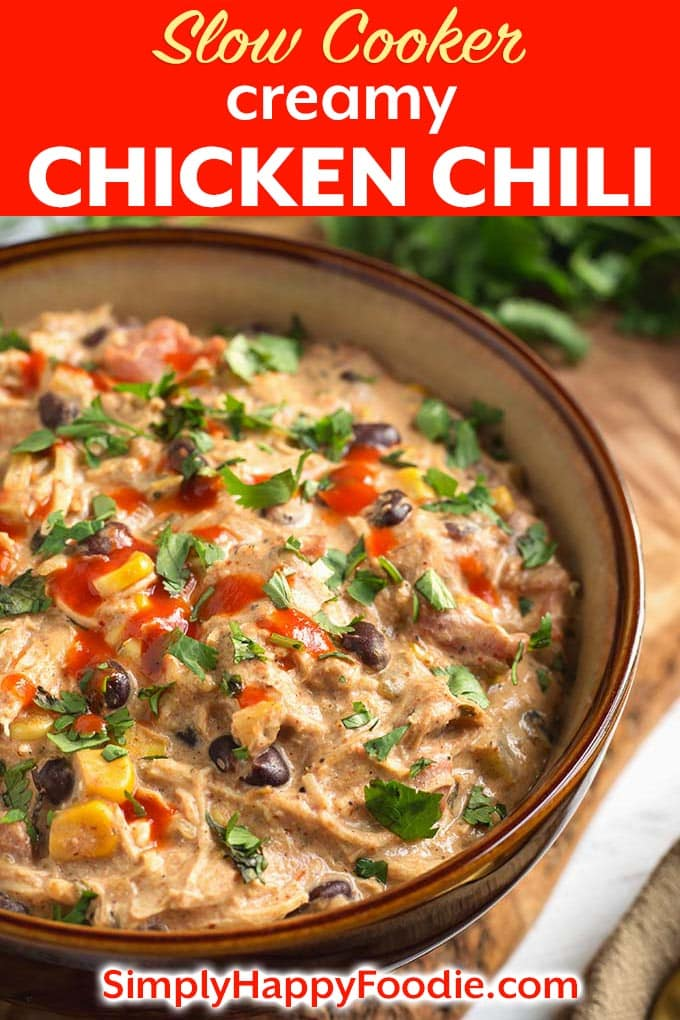Slow Cooker Creamy Chicken Chili not only tastes delicious, but your home will smell so good while it's cooking! This is a very easy recipe to prepare. Dump it all in the slow cooker and walk away! This Crock Pot creamy chicken chili is a great cool weather meal that the whole family will love. simplyhappyfoodie.com #slowcookerchickenchili #crockpotchickenchili