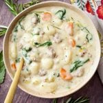 This Slow Cooker Creamy Sausage Gnocchi Soup recipe is a delicious, rich comfort food. What's better than a comforting bowl of hearty soup? This crock pot sausage gnocchi soup is amazing! Serve it with fluffy dinner rolls and you will have a wonderful and satisfying meal! simplyhappyfoodie.com #slowcookersausagegnocchisoup #crockpotsausagegnocchisoup