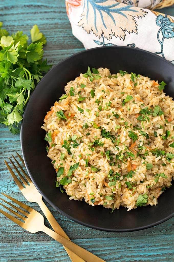 Instant Pot Brown Rice Pilaf is a delicious side dish recipe that cooks to the perfect texture, and is very flavorful. Enjoy this pressure cooker brown rice pilaf recipe with chicken, beef, pork, fish, or any other main dish you like. Make this a vegetarian Instant Pot brown rice pilaf by using veggie broth. Instant Pot Recipes by simplyhappyfoodie.com #instantpotbrownricepilaf #pressurecookerbrownricepilaf