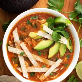 Instant Pot Chicken Tortilla Soup is a very flavorful Mexican soup. If you haven't had a tortilla soup before, the spices, herbs, and corn tortillas give this Pressure Cooker Chicken Tortilla soup a wonderful fiesta of flavor! Instant Pot recipes by simplyhappyfoodie.com #instantpotchickentortillasoup #instantpotsouprecipes