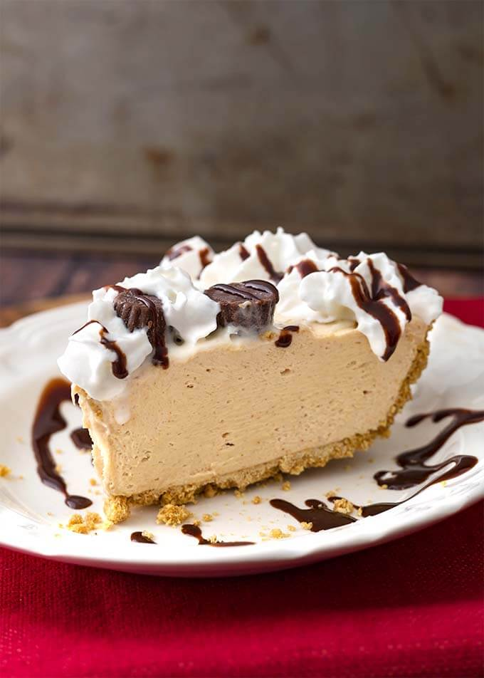 Slice of No Bake Peanut Butter Pie on a white plate