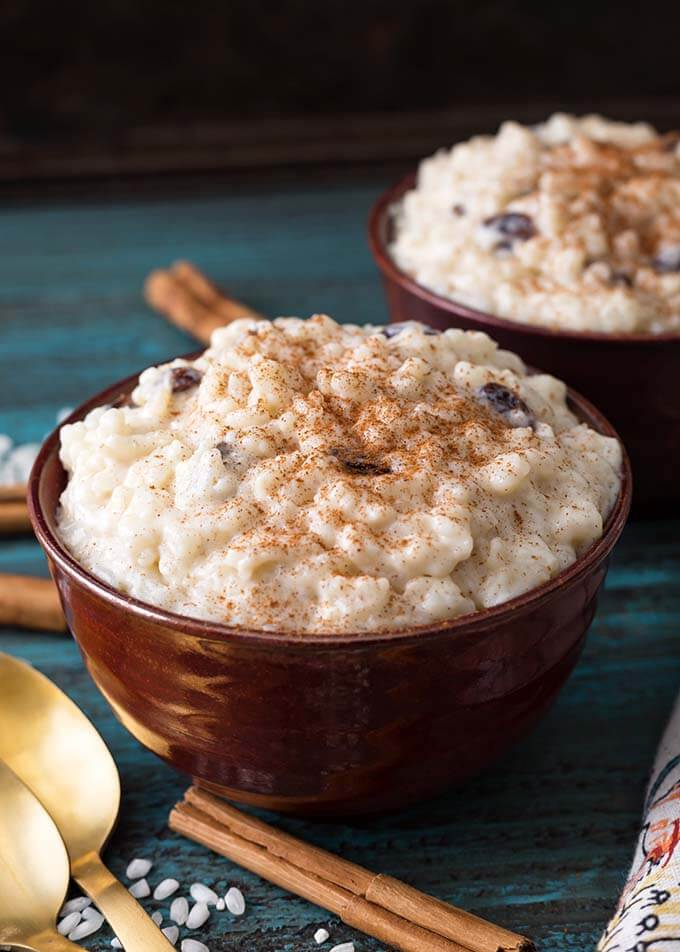 Instant Pot Rice Pudding is creamy, sweet, and deliciously comforting. It is so easy to make this pressure cooker rice pudding recipe. A family favorite! Instant Pot recipes by simplyhappyfoodie.com #instantpotricepudding #pressurecookerricepudding