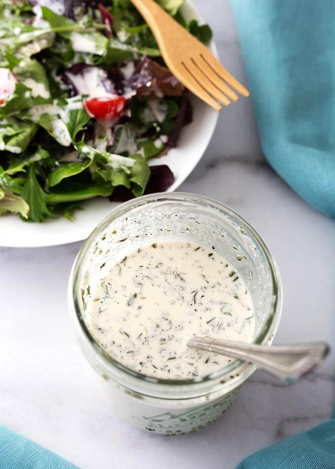 Homemade Ranch Dressing Mix is surprisingly easy to make from spices you may already have in your pantry. This ranch seasoning mix has all of the great ranch flavor, and you control the salt! Use this ranch dressing mix recipe for pot roast, salad dressing, dip, an in many other tasty recipes! simplyhappyfoodie.com #homemaderanchdressingmix #homemaderanchseasoningmix
