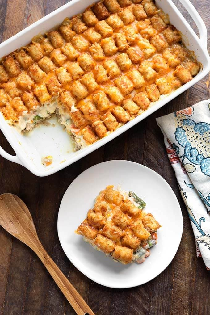 This Hotdish Tater Tot Casserole is a true American classic comfort food! Everyone from Grandmas to busy moms and dads have been making this easy Tater Tot Casserole recipe for decades. simplyhappyfoodie.com #hotdish #tatertotcasserole