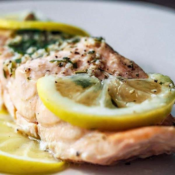 close up of salmon with lemon slices