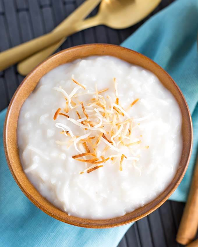 Instant Pot Coconut Rice Pudding is a light, gently flavored, vegan coconut rice pudding. This is an Instant Pot Dump and Start recipe that has just 5 ingredients. You will love how fast this pressure cooker coconut rice pudding comes together! simplyhappyfoodie.com #instantpotcoconutricepudding #veganinstantpot #pressurecookercoconutricepudding
